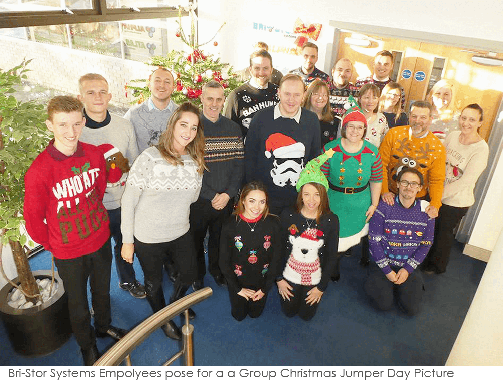 The team in Christmas jumpers