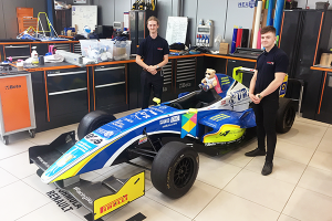 Alpha Apprentices with Formula Renault race Car